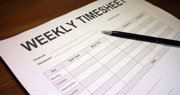 Someone filling out Weekly Timesheet Form